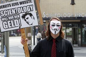 An Anonymous member protesting outside a Church of Scientology building in Hamburg, Germany in April 2012.