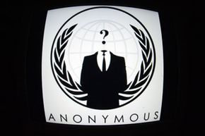 The Anonymous logo is a suited man with a question mark in place of a head.