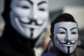 Protesters in Bahrain wearing Guy Fawkes masks used by the Anonymous movement.