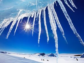Crystal blue skies in icy Antarctica. See pictures of glaciers.