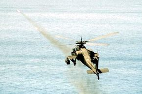 An Apache fires two Hellfire missiles in a training exercise.