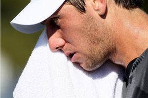 Carsten Ball of Australia wipes the sweat from his face during his first-round singles match at the 2010 U.S. Open. He's wiping away some sweat from the apocrine sweat gland -- that's the smelly kind. See more men's health pictures.