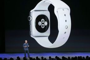 The slide above Apple CEO Tim Cook shows the Digital Crown on the side of the Watch and the buttons and the back of the device.