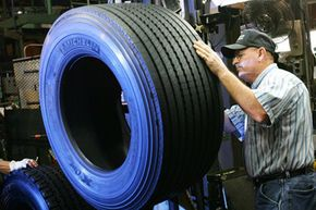 Image Gallery: Car Safety Jerry Alexander inspects the Michelin X-One truck tire at the Commercial Truck tire plant in Spartanburg, S.C. See more car safety pictures.