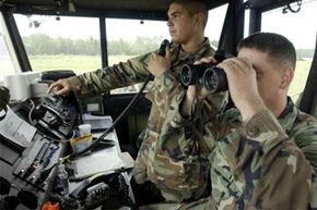 U.S. Army soldiers man a mobile tactical air traffic control tower over a landing area where the Army's Marine Division 1st Battalion, 3rd Aviation Regiment were refueling and rearming for a training exercise.