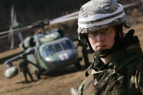 A U.S. soldier takes part in a 2008 joint medevac field training exercise with South Korean soldiers in Yangju, South Korea.