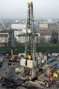 A drilling derrick that's part of the Deep Heat Mining energy project rises up in Switzerland in 2007. Geothermal power could provide 250,000 times more energy than the world currently consumes yearly, according to AP.