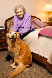 Can't bear to leave your dog behind? Some assisted-living facilities allow pets.