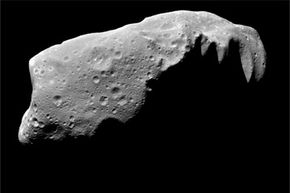 There's Ida. She's roughly 32 miles (52 kilometers) across. An asteroid like her would spell big trouble for our planet if she ever got the notion to visit. See more space dust pictures.