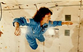 """Christa McAuliffe trains for microgravity aboard NASA's KC-135 """"zero gravity"""" aircraft, nicknamed the """"vomit comet"""" for the flights' ability to upset stomachs. McAuliffe was a civilian astronaut, part of NASA's Teacher in Space program."""