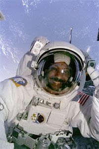 Mission Specialist Winston Scott steps outside the Columbia for a spacewalk on mission STS-87.
