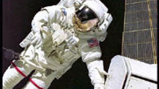 How do astronauts function in their space suits for hours at a time?