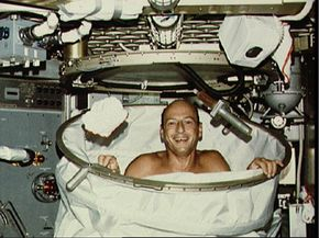 Astronaut Charles Conrad Jr., Skylab 2 commander, smiles for the camera after a hot shower in the shower facility.