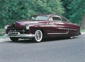 Originally completed in 1952, the Buddy Alcorn Mercury was brought to Barris Kustom Autos in 1955 and painted a rich eggplant color. See more custom car pictures.