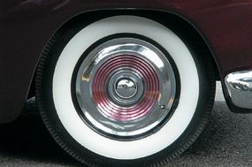 The hubcaps on the Buddy Alcorn came from a 1956 Mercury. They were modified with bullet centers and colored paint, an intuitive and original design.