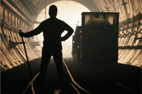 A worker pauses for a second inside the Channel Tunnel in April 1992. Completed in 1994, the tunnel stretches for more than 30 miles.