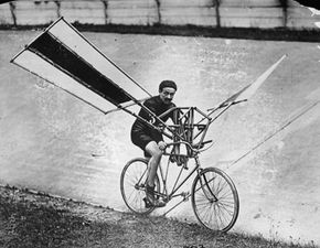 Flight Image Gallery A bicycle with wings attached to its frame for an early attempt at a flying machine, circa 1900. This, strangely enough, is a tame design. See more flight pictures.