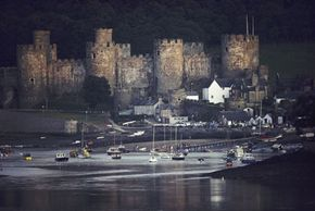 The massive, eight-towered Conway Castle and its walled garrison town, the latter of which the seven-year-old John Williams expected to jump off of and fly.