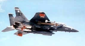 Air-to-air view of GBU-28 hard target bomb on an F-15E Eagle