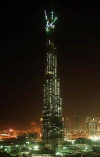 The Burj Dubai lights up the city