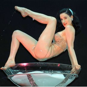 Neo-burlesque artist Dita Von Teese performs her signature act in a giant champagne glass.