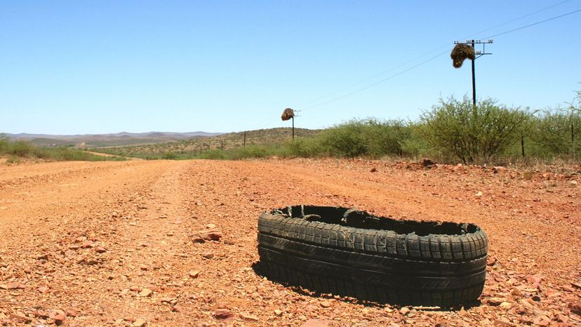 burst tire on road