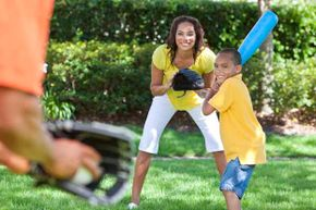 It's best to use plastic bats and balls when playing in the backyard.