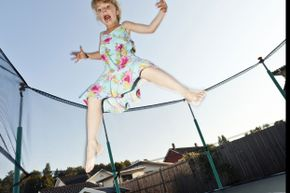Trampolines can be fun, but you have to be aware of potential dangers. Get an enclosure, stick to one person jumping at a time, and always supervise children.