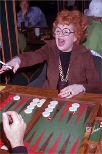 Lucille Ball gets in a spirited game of backgammon, just as her leisure-loving ancestors did.