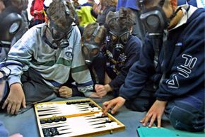 Israeli schoolboys bust out their backgammon set during a 2002 bomb scare.
