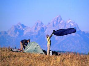 A couple sets up camp near Jackson Hole, Wyoming.