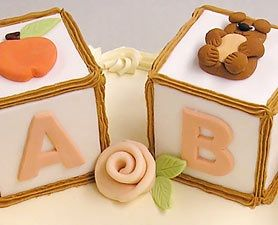 A classic baby item becomes an easy-to-make baby shower cake.