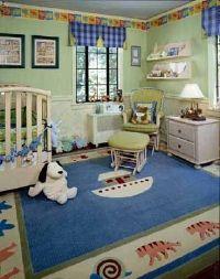 A custom rug bordered with animals underscores the Noah's ark theme. Designer: Karen Cashman, Perspectives