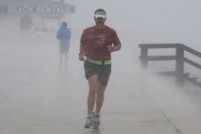 John Harris, who's training for a triathlon, runs in the wind and rain as the effects of Hurricane Alex are felt on the Texas coast on June 30, 2010.