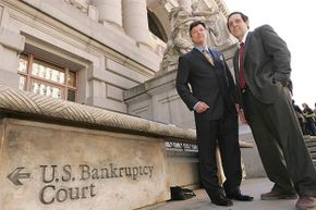 Bill Bubbers (left) and Tony Christ of Loral Space and Communication stand in front of the U.S. Bankruptcy courthouse in New York City.