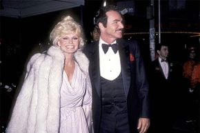 Burt Reynolds and Loni Anderson attend a movie premiere back when they were happily married. Even though Reynolds declared  bankruptcy after their divorce in 1993, he still owes her $150,000.