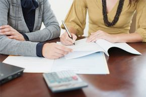 If you've filed for bankruptcy and need a loan, be sure to pay bills on time and try to curb your debts.