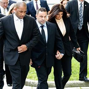 Teresa and Giuseppe 'Joe' Giudice, stars of the reality TV series 'Real Housewives of New Jersey' hold hands as they arrive at U.S. federal court in Newark, New Jersey. They were convicted of bankruptcy fraud.