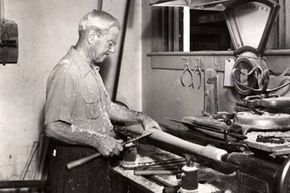 """John Andrew """"Bud"""" Hillerich, creator of the """"Louisville Slugger,"""" makes a bat in the Louisville, Ky. factory circa 1930's."""