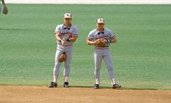 Billy and Cal Ripken, Jr. of the Baltimore Orioles survey the field during the ill-fated 1988 season. See more sports pictures.