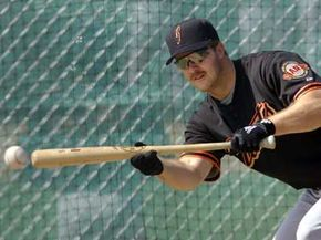 San Francisco Giants' second baseman Jeff Kent bunts the ball during 2001 spring training in Scottsdale, Ariz.