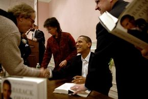 """Obama signs copies of his second book, """"The Audacity of Hope"""" -- which includes his positions and plans on issues facing the U.S. -- in New Hampshire in 2006."""