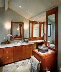 Towels in the same neutral color family                              as the walls blend with the setting.