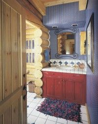Splashes of color add to this bath's rustic charm.