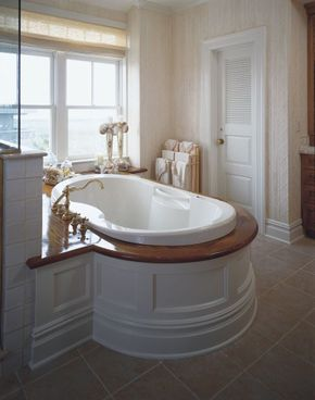 The tub in this white-on-white bathroom gives bathers a seaside view.