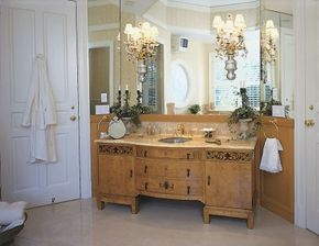 Superbly matched wood grains and intricate ebony detailing on the vanity lend an exotic air to this bath.