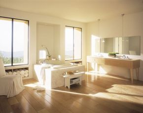 The spacious ambiance in this modern bathroom is inspired by California spa designs.