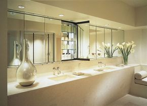 This glamorous modern bathroom has all the creature comforts, and then some.