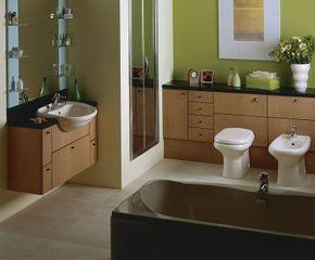 The unique toilet, bidet, and sink give this modern bath an artistic flair.