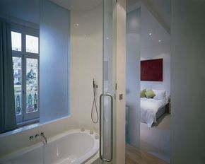 Translucent glass panels create a sense of privacy, while enhancing the feeling of light and space.